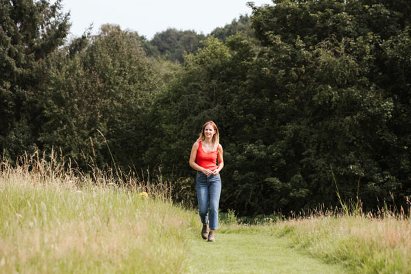 Katie Rushworth image of her walking through an alternative lawn
